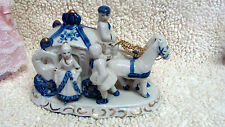 Colonial Coach with figurines white  blue  porcelain  7'' by 3 1/4'' gold trim