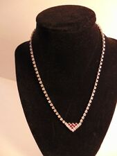 Older rhinestone necklace:white crystals accented with red at the pendant
