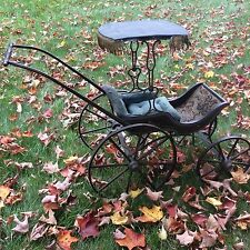 Antique Victorian doll carriage excellent paint and wooden wheels