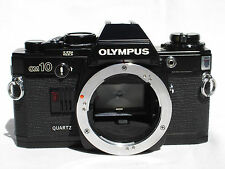 Olympus OM-10 Camera Body only  Quartz. Black. OM10  Works good!   SN1213009