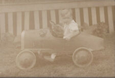 1920s? PHOTO YOUNG BOY SEATED IN BOAT TAIL RACER PEDAL CAR