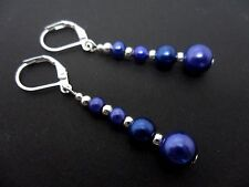 A PAIR OF DANGLY BLUE GLASS PEARL  SILVER PLATED LEVERBACK HOOK EARRINGS.