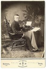 A man with an early typewriter, identified in pen on bottom margin as... Lot 454