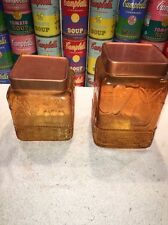 Pair vintage yellow Amber glass canisters w/ embossed fruits & copper lids 1970s