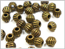 25 kleine Metallperlen bronze bicone 4.5*4mm