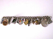 Vintage 1960s Charm Bracelet with 27 Charms,21 are sterling,5 brass,1 copper