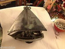 Metal scrap sculpture of parts and artifacts steampunk sailboat