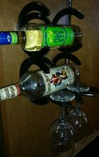 Horseshoe wine rack mounts to a wall or cabinet hold two glasses or bottles