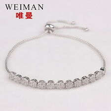 Sparkling rond cut cubic zirconia adjustable bracelet in white gold plated