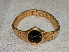 Ladies Beautiful SEIKO V701-2C00  Gold Tone Black Face  Quartz Watch