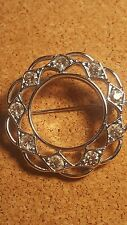 Vintage brooch. signed Sarah Coventry. silver tone circle clear rhinestone