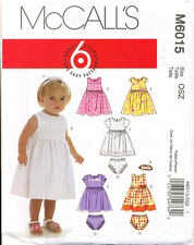 MCCALL'S SEWING PATTERN 6015 BABY SZ SM-XL LINED DRESSES, NAPPY COVERS, HEADBAND
