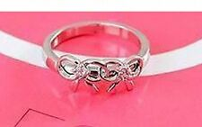 Cute silver tone twin bow ring with crystal