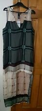 Tj collection silk dress cut out on one side on the bottom, new size L