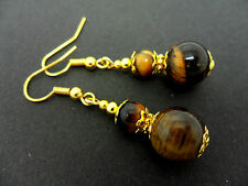 A PAIR OF TIGERS EYE  GOLD PLATED DROP DANGLY EARRINGS. NEW.