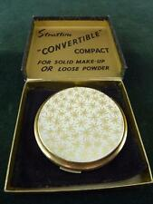 Stratton compact white background with fern pattern on the front with pouch box