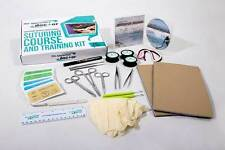 Suture kit with sutures, suturing instruments, practice skin, suturing training