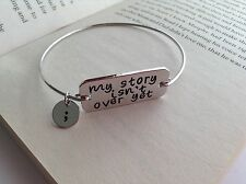 SILVER PLATED MY STORY ISN'T OVER YET WORD CHARM BANGLE BRACELET JEWELLERY