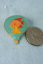 HOT AIR BALLOON PIN HAS FISH ON IT