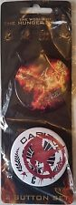 "THE WORLD OF THE HUNGER GAMES Set of 2 Buttons; New/Sealed 2.25"" Diameter"