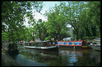 579019 Tourist Boat Glides Along Regents Canal London England A4 Photo Print