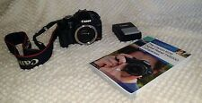 Canon EOS Rebel T1i / EOS 500D Digital SLR Camera - Black (Body Only) with book