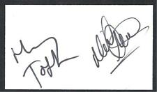 A 13cm x 7.5cm Plain White Card Signed by Harry Toffolo & Neil Adams of Norwich