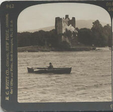 STEREOVIEW, MAN IN CANOE IN KILLARNEY IRELAND IN FRONT OF ROSS CASTLE.