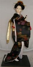 ORIENTAL JAPANESE GEISHA GIRL DOLL TRADITIONAL BLACK GOLD  DRESS & HOLDING A FAN