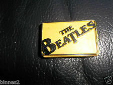 THE BEATLES 1960's YELLOW AND BLACK PLASTIC RECTANGULAR  BROOCH-BADGE-PIN