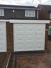 fully installed 1/3 x 2/3 square design white side hinged garage door and frame