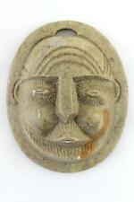 A small vintage carved stone wall mask/sculpture. Tribal style