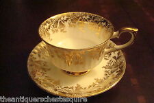 Paragon England cup and saucer, cream color, gold  & flowers design[a4-64]