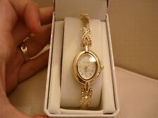 NEW WOMENS BAY STUDIO WATCH WHITE FACE YELLOW GOLD TONE RHINESTONES STRETCH BAND