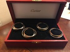 CARTIER TRINITY BRASS NAPKIN RINGS, IN BOX, SET OF 4, DISCONTINUED, RARE