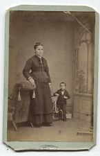 CDV WOMAN WITH MIDGET STANDING NEXT TO BICYCLE. RARE.