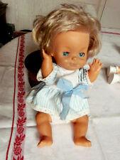 Ancienne poupée Bella avec ses disques