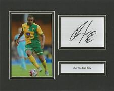 A 10 x 8 inch mounted display signed by Vadis Odjidja-Ofoe when at Norwich City.