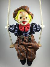 Vintage Marionette Clown String Puppet Doll Sitting on a Swing Porcelain face