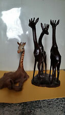 Two Giraffe Sculptures 1 bt Rick Cain and 1 By Mutiso