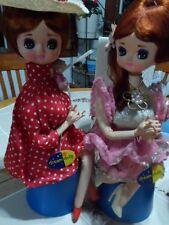 Vintage Dakin Big Eye Pair  Sitting Pose Dolls on Musical Turning works great.