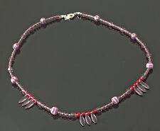 Exclusive, handmade necklace with amethyst and red beads with Czech daggers
