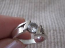 Silver ring with white crystal stone