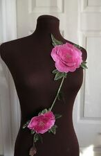 A long, bright pink and green 3D guipure lace embroidered neck trim applique.