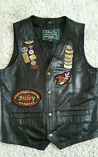 Leather waist coat  small with a collection of hog and harley badges and patches