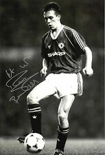 A 12 x 8 inch photo personally signed by Russell Beardsmore of Manchester United
