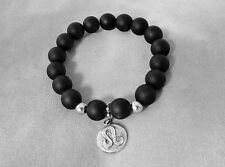 Silver double faced LEO SIGN charm in an Elastic Black Onyx Bead Bracelet