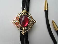 Bolo tie with filigree surround rock and roll country and western stagewear