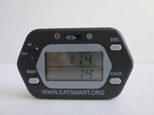 """PEDOMETER with CALORIE COUNTER and CLOCK . BLACK. 2 1/2"""" x1 1/2 """"x 1/2""""."""
