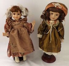 TWO 16 INCH COLLECTABLE PORCELAIN DOLLS ON STANDS